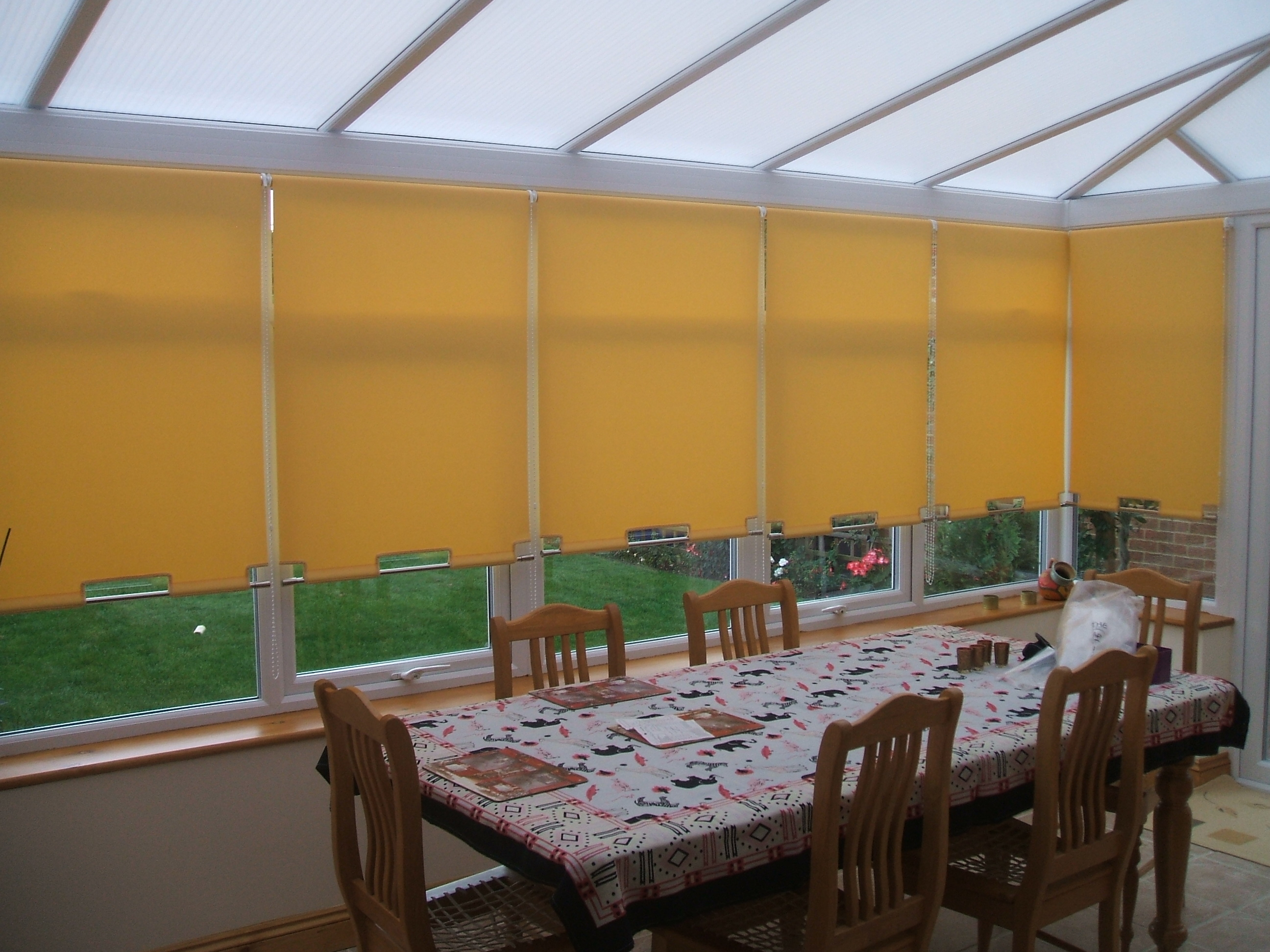 Roller Blinds In Conservatory Shaped Bottoms With Chrome Poles Baileys Blinds